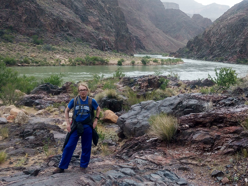 Bradley Smith standing along bank of Colorado River