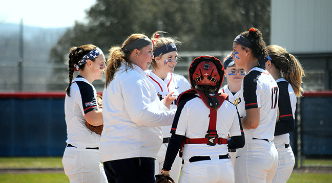 Coach Emily Goshorn speaks with Shippensburg University softball players during a mound visit