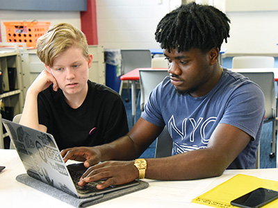 Two students with laptop