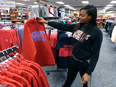student shopping for sweatshirt