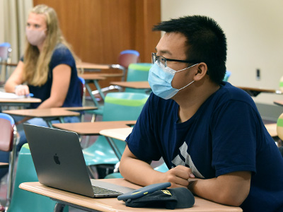 Student wearing mask in classroom