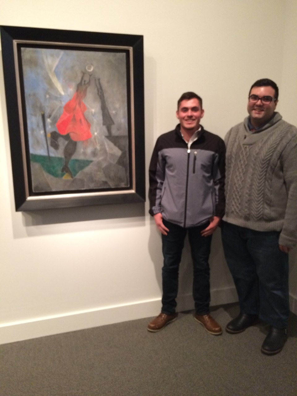 2 male students pose in art musuem