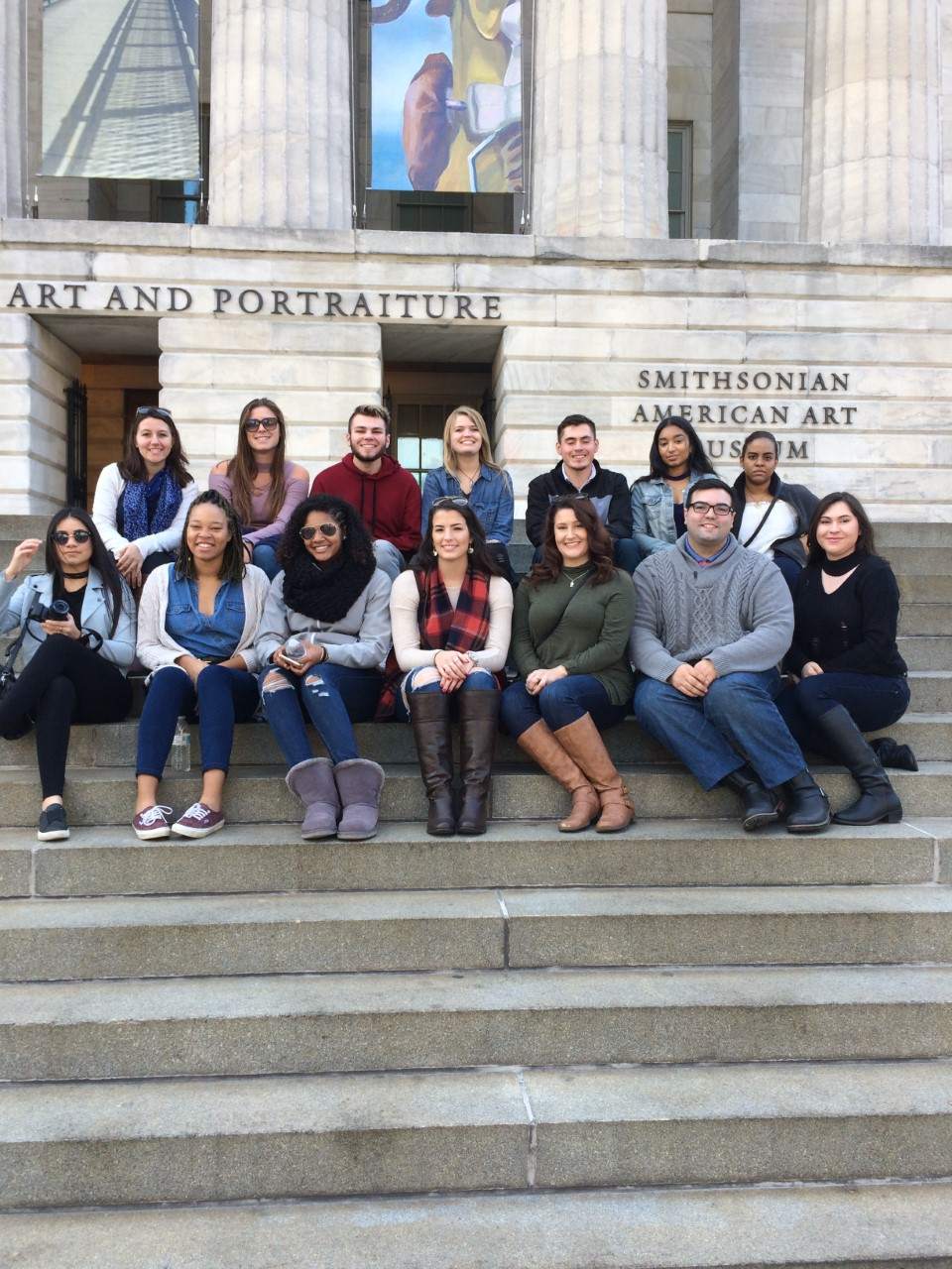 Group of students pose on the steps of art museum
