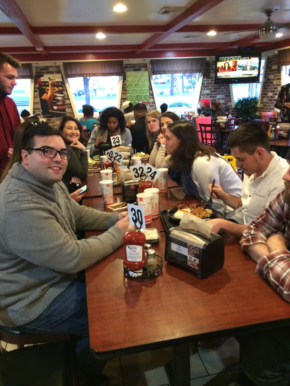 Group of students eat at Peruvian restaurant